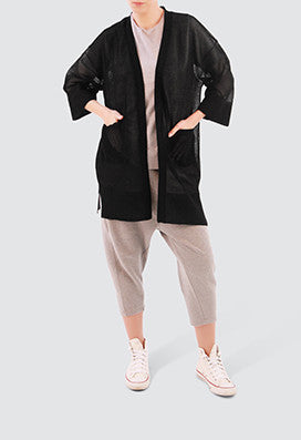 Black cropped sleeve cardigan. Luxmix brings new and trendy styles of cardigans to the table. With Luxmix's tailor made design of cropped sleeves, it offers a chic palate to this easy wear.