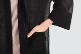 Black cropped sleeve cardigan. The cardigan pockets offer a desired effect of comfort indulged with style.