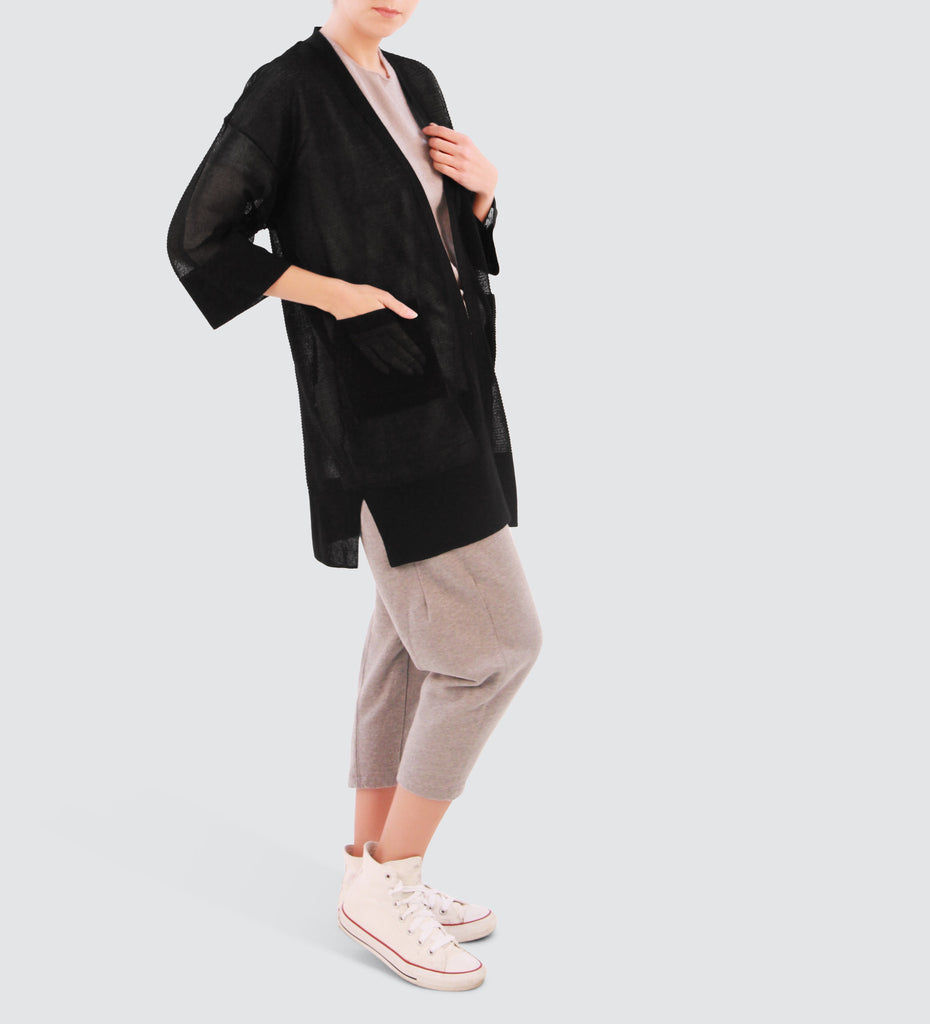 Black cropped sleeve cardigan. Mix and Match the cardigan with any trouser or top and rock the look!
