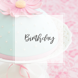 Birthday sign over pink and mint cake with large pink flower