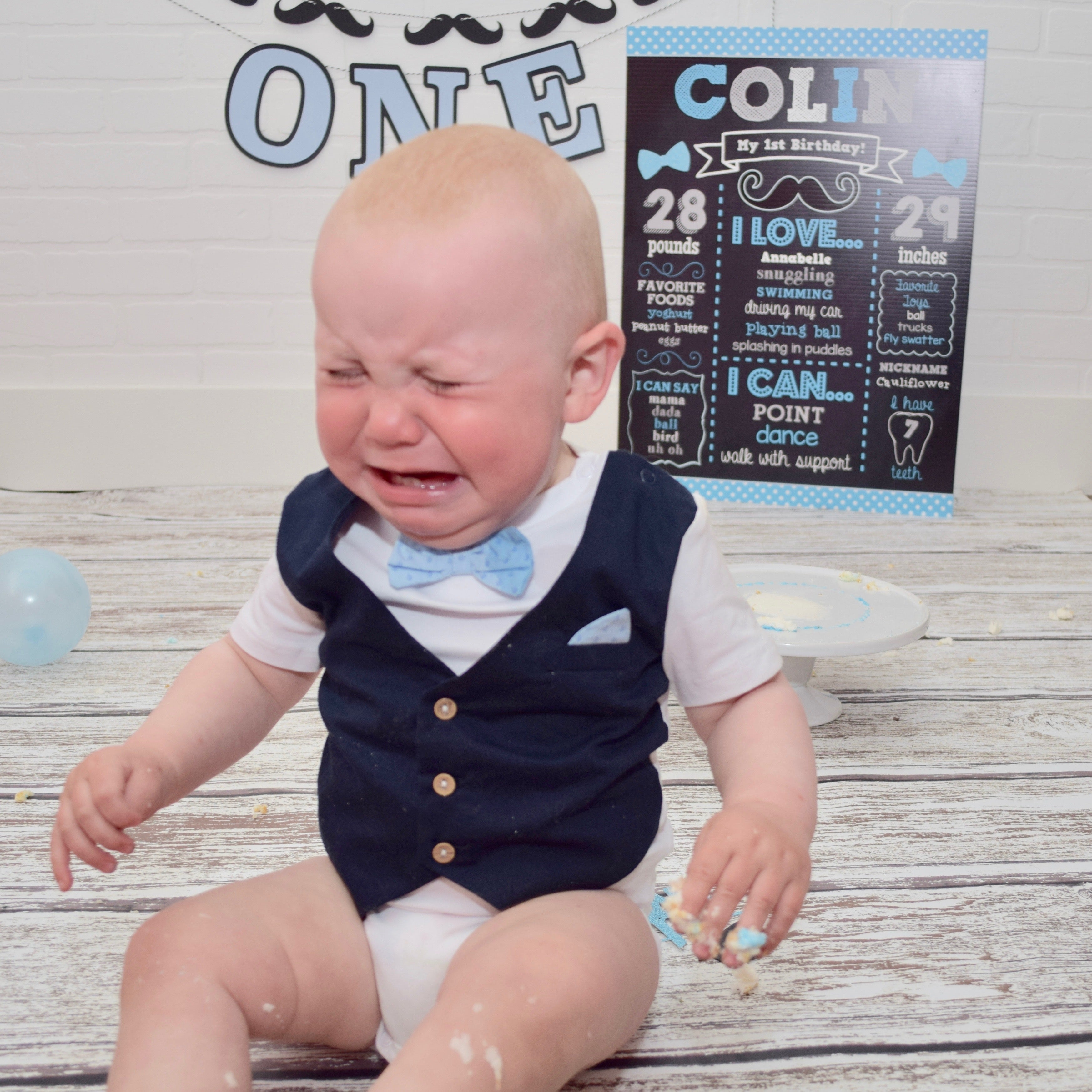 Baby cries after cake smash