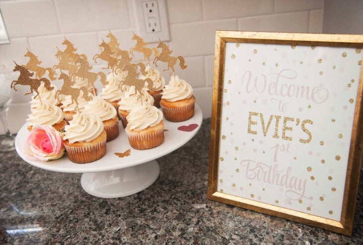 gold unicorn cupcake toppers and pink and gold welcome sign