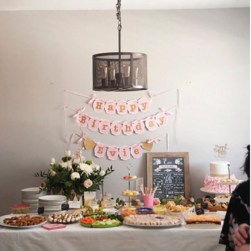 food table and pink and gold banner for 1st birthday