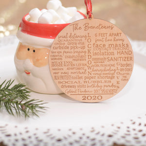 Typography Quarantine Ornament leaning on Cup of Hot Cocoa
