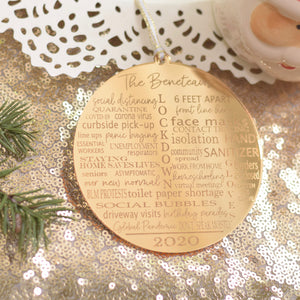 Typography Pandemic Christmas ornament on a gold sparkly table cloth