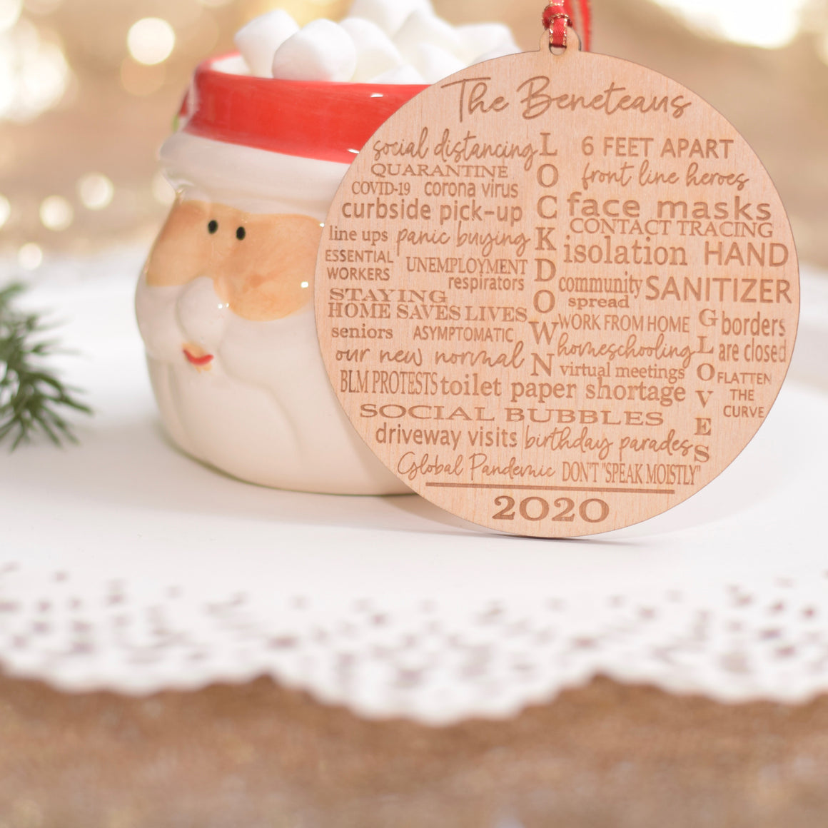 Wooden Quarantine Ornament resting on a Santa Christmas Mug