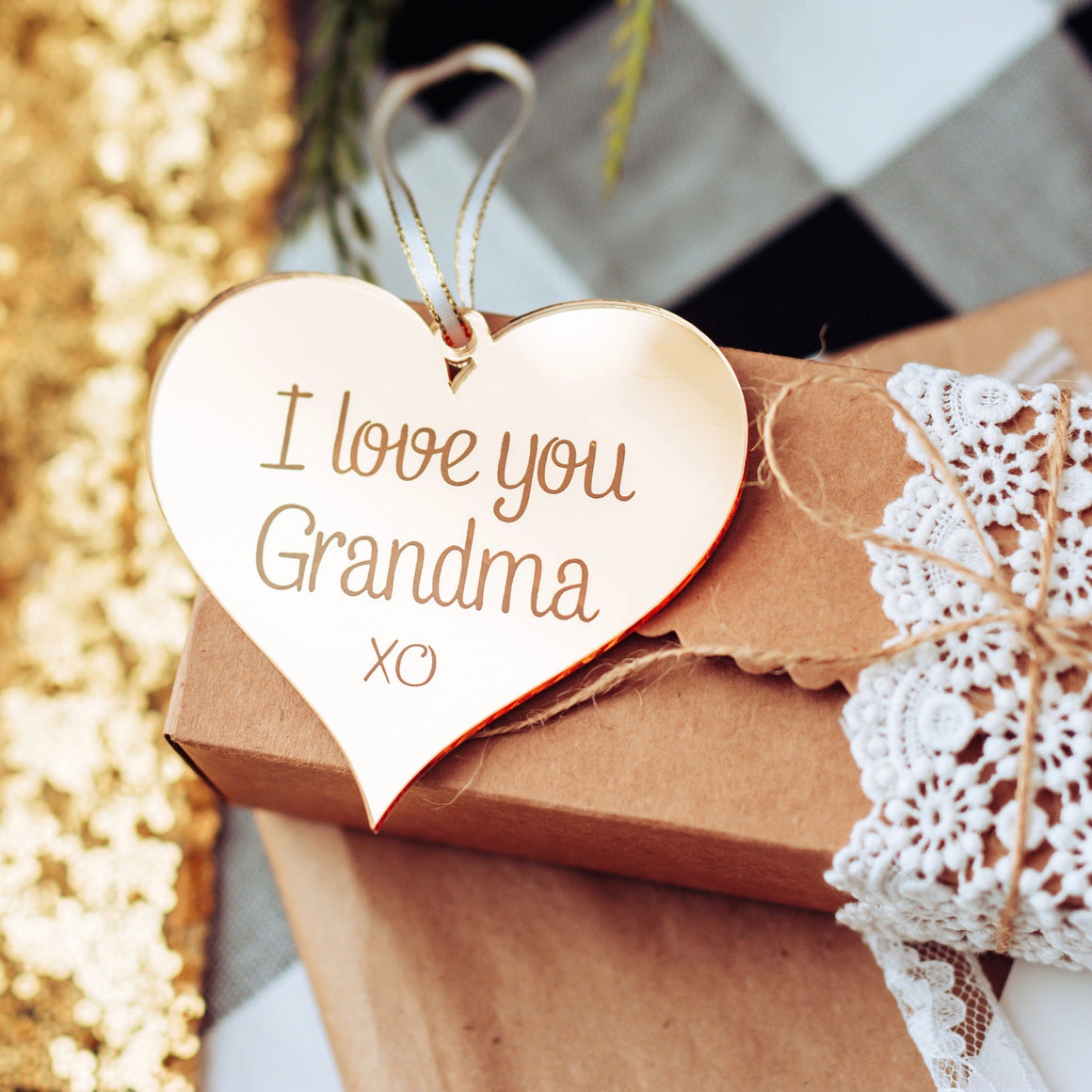 I Love you grandma ornament lying on a gift box