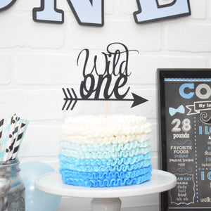 Black wild one cake topper on blue ombre cake