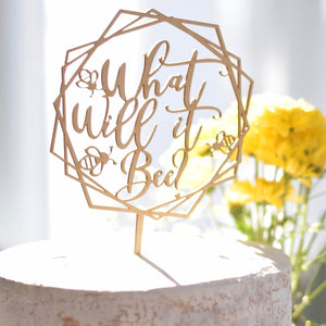 Geometric Gender Reveal Cake Topper on a white cake and yellow flowers