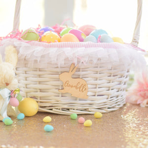 Easter basket on a table with bunny tag