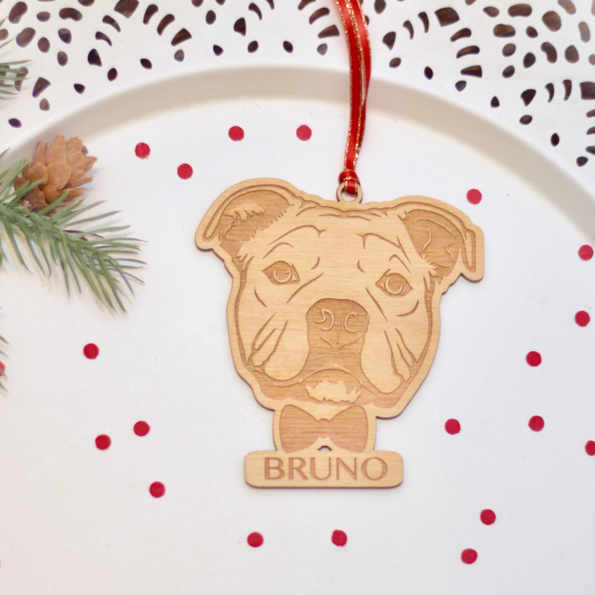 French bully ornament on a cake plate with red confetti