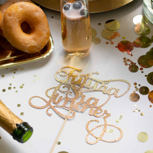 Gold Futura Señora cake topper on table with donuts and champagne