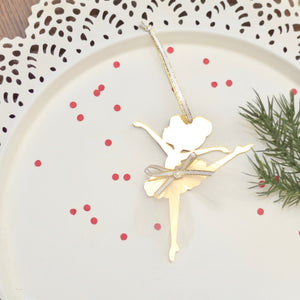Gold Christmas Tree ornament with white tutu on a white cake plate