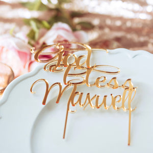 gold acrylic cake topper on a white plate for baptism or confirmation