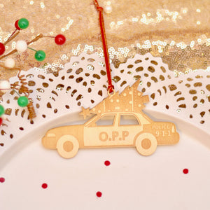 O.P.P. cruiser car with Christmas tree on top of it for OPP Christmas gift