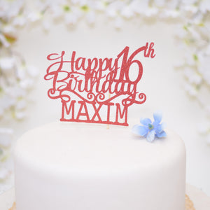 Red happy 16th birthday Cake topper on a white cake with blue flowers