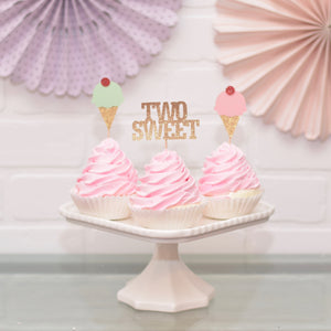 two sweet cupcake toppers on pink cupcakes