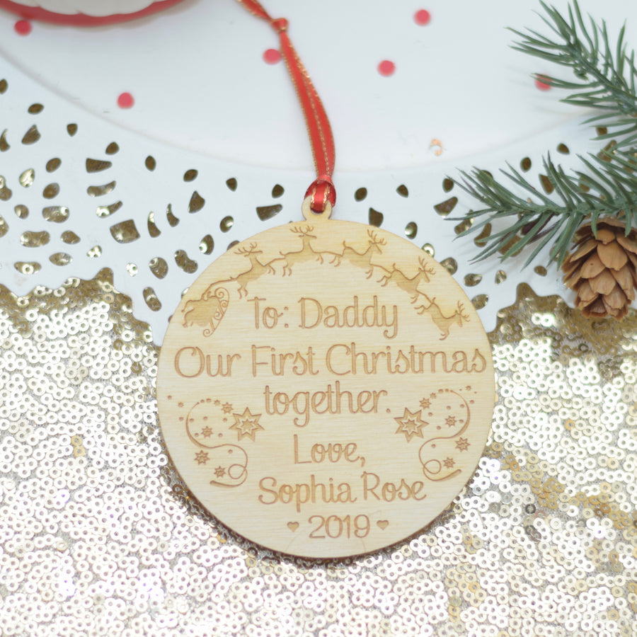 To Daddy Our first Christmas together ornament on a white plate