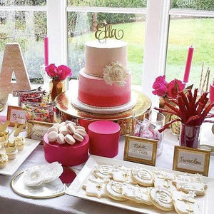Ella cake topper on pink and gold sweets table