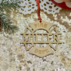 fireman ornament on a sparkly gold table cloth with Christmas greenery