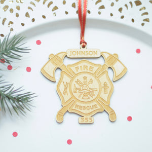 fire fighter ornament on a cake plate