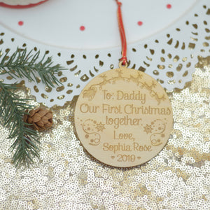 Christmas ornament for new dad with Santa and sleigh with Christmas greenery