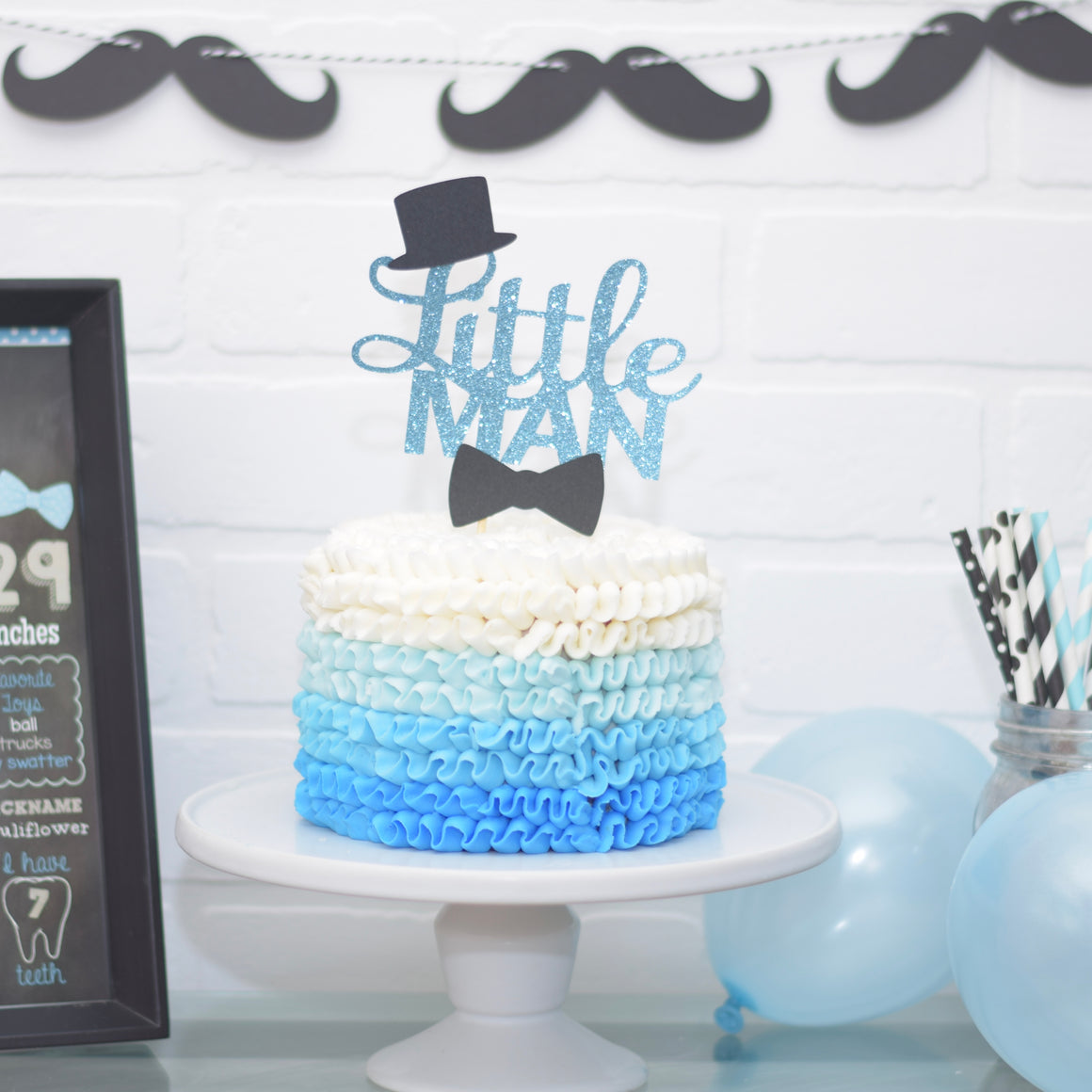 Blue and black little man cake topper on blue ombre cake