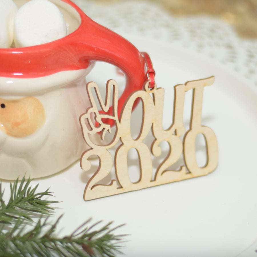 Wooden peace out 2020 ornament with greenery and red ribbon