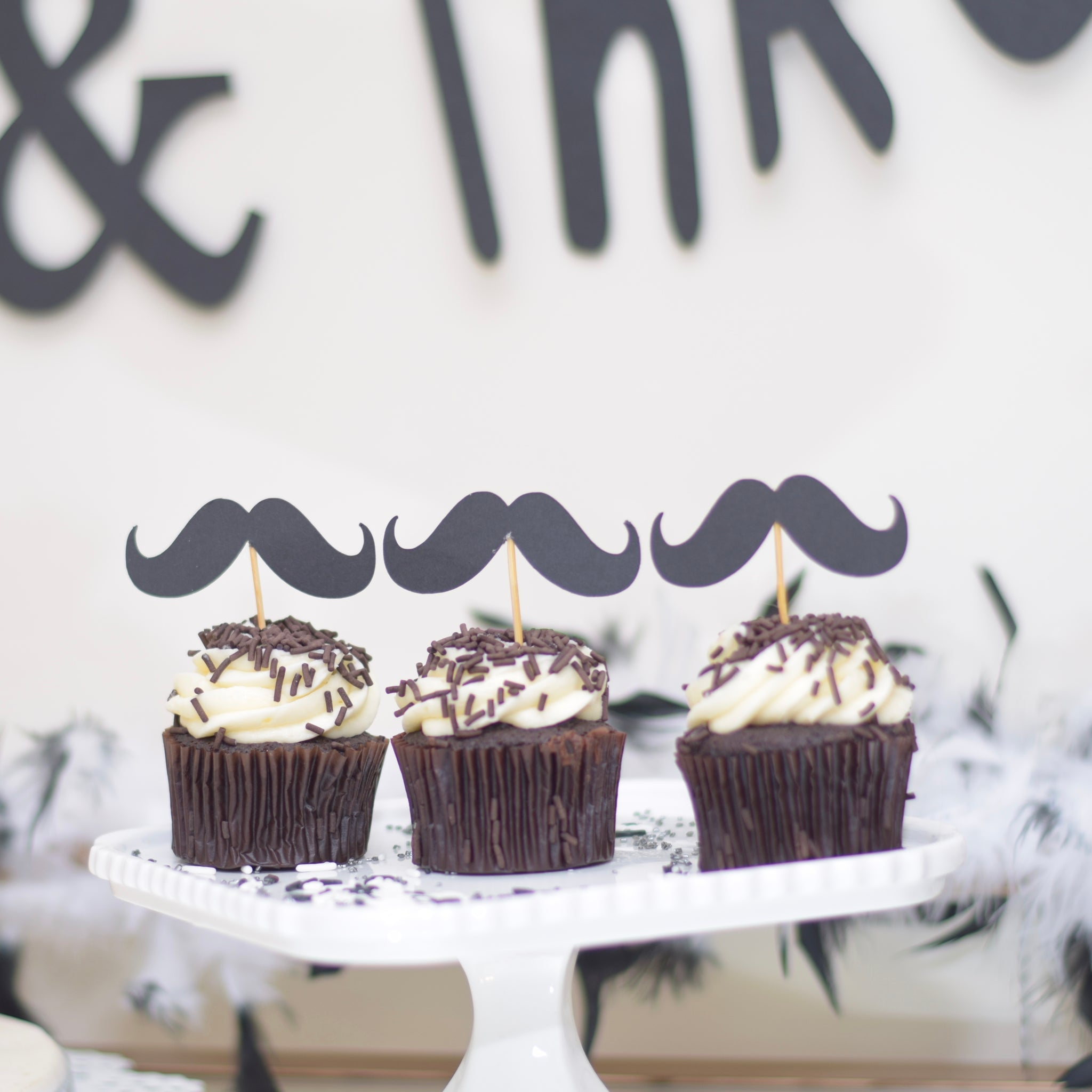 Set Of Three Black Moustache Cupcake Toppers With And White Cupcakes