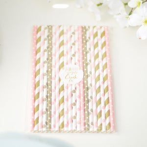 assorted pink and gold paper straws with flowers