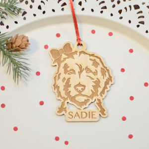 Wooden Christmas ornament of golden doodle with bow in hair