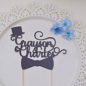 Personalized Mr Onederful cake topper with top hat and bowtie on a plate with blue flowers