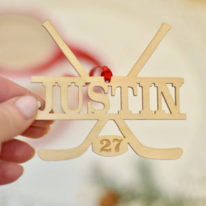 Lady holding a personalized hockey ornament