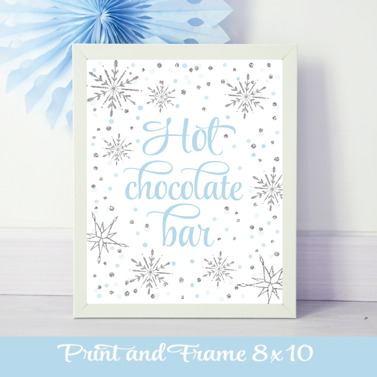blue and silver hot chocolate bar sign in a white frame with silver snowflakes