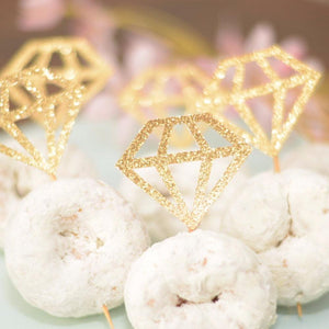 gold sparkly diamond ring in three powdered mini doughnuts