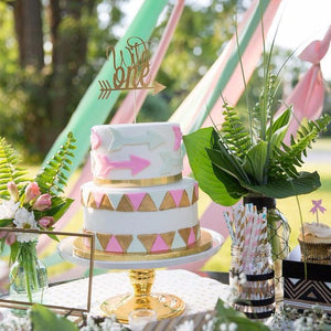 Wild one cake topper on fun boho inspired cake and table