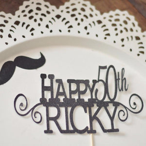 Happy 50th Ricky intricate and detailed black cake topper on white background with mustache cutout