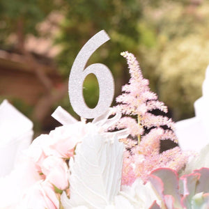 Number 6 silver sparkle glitter table numbers surrounded by flowers