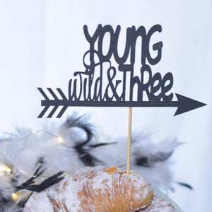 young wild and three black sparkle cake topper with arrow