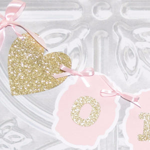 details of birthday banner with gold sparkle glitter heart