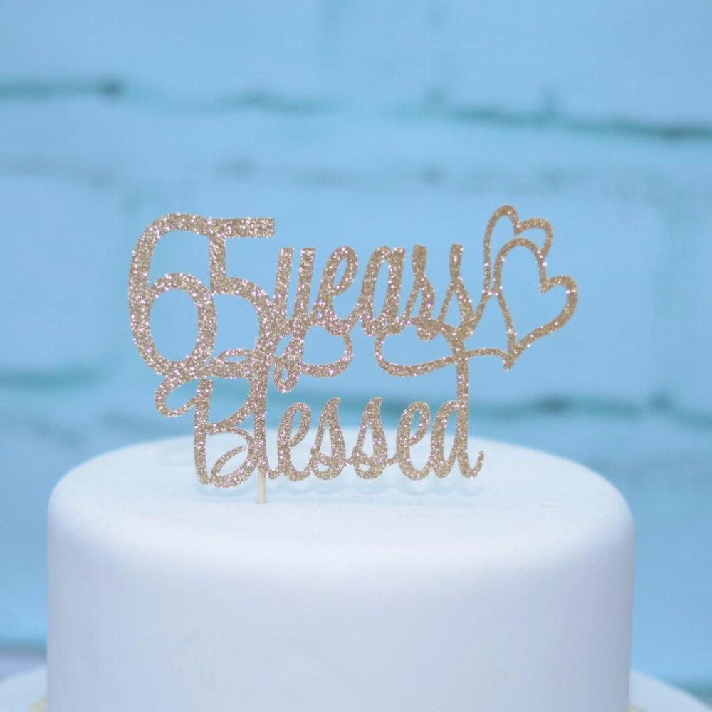 65 Years Blessed Extra Shiny Glitter Cake Topper On White With Blue Background