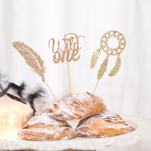 Wild one gold sparkle cupcake topper accented with a feather and dream catcher cupcake topper