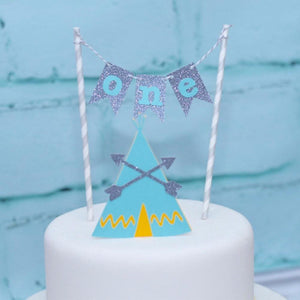 details of first birthday cake topper with blue and yellow tepee details