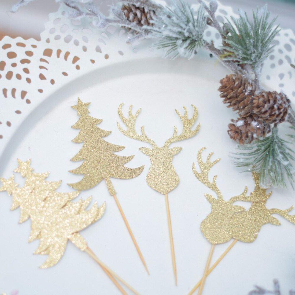 gold glitter deer and pine tree cupcake toppers on white plate with pine-cone details