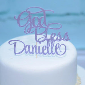 God Bless Danielle lavender glitter cake topper on white wedding cake