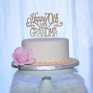Happy 70th Grandma birthday cake topper on ivory cake with pink flower