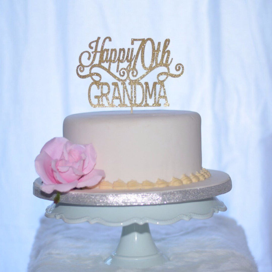 Happy 70th Grandma gold sparkle cake topper on white cake
