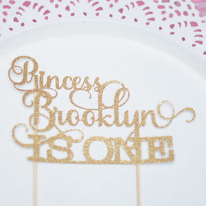 Princess Brooklyn is one gold glitter sparkle cake topper