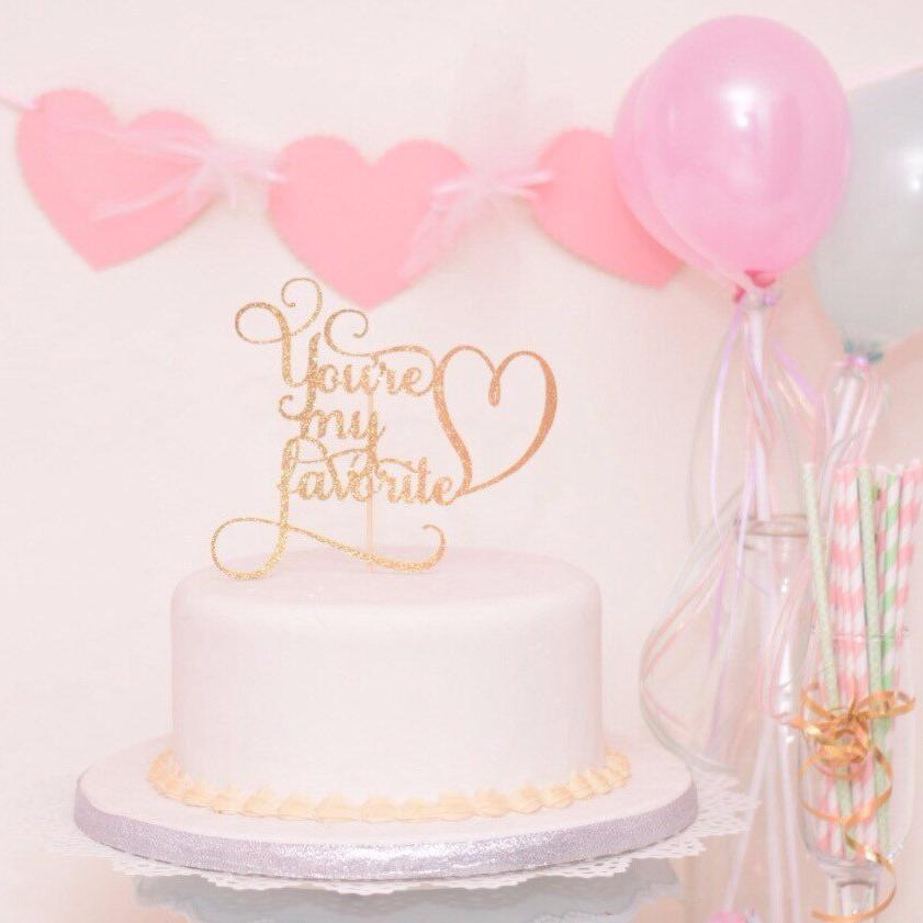 You're my favorite gold sparkle cake topper with heart in white cake with heart banner and pink balloons