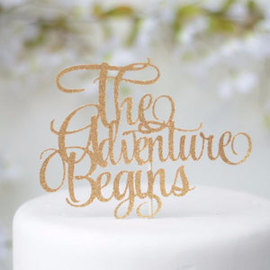 The Adventure Begins gold sparkle glitter cake topper